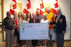 Heather Hines (2nd from left) and the Optimist Club of Byron, present the Joe Ryan (left) Chairman of the Outdoor Event and Branch 533 President, John Morris (Right) with a cheque for $768.29.